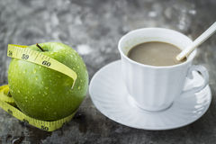 Green apple with waist and measuring tape and coffee Stock Photography