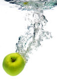 Green apple in water Stock Photography