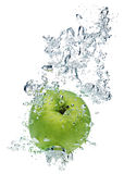 Green apple in water Royalty Free Stock Photos