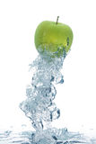 Green apple in water royalty free stock photo