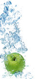 Green apple in water royalty free stock image