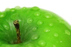 Green apple with water drops Royalty Free Stock Photography