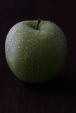 Green apple. With water drops royalty free stock photography