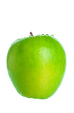 Green apple with water drops closeup Royalty Free Stock Images