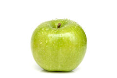 Green apple with water drops Stock Images