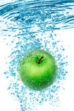 Green Apple in the Water. Royalty Free Stock Images