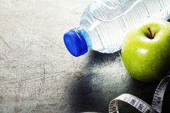 Green apple, water and measuring tape. Health and diet concept Stock Photography
