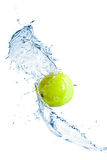 Green apple with water splash, isolated Stock Image