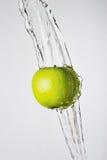 Green apple and water splash Stock Image
