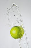 Green apple and water splash Royalty Free Stock Photo
