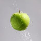 Green apple in a waterfountain Royalty Free Stock Photos