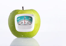Green Apple and weight measurement meter Stock Photography