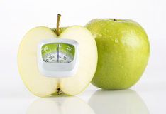 Green Apple and weight measurement meter Stock Photo