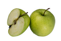 Green apple. Green wet apple sliced in half Royalty Free Stock Images