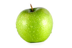 Green apple on a white background royalty free stock photography