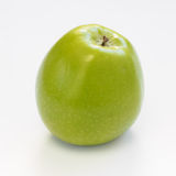 Green apple on white background. An apple on white background Stock Image