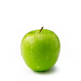 Green apple on white background. Green juicy Apple on white background Royalty Free Stock Photo