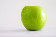 Green apple in white background Royalty Free Stock Photography