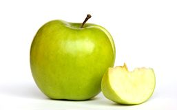Green apple with a slice Stock Photos