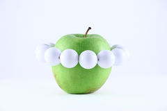 Green apple with a white beads. Removed on a white background close up Royalty Free Stock Photos