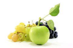 Green apple and white and black grape Stock Photography