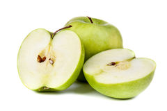 Green Apple. Whole and cut open green apple on white background Stock Images