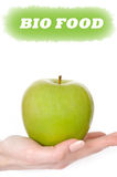 Green apple in woman hand. bio food Royalty Free Stock Photography