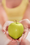 Green Apple In Woman Hands Royalty Free Stock Image