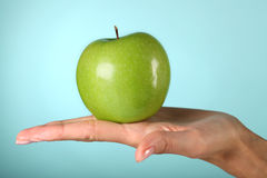 Green apple. In the woman's hands Royalty Free Stock Photo