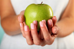 Green apple. In the woman's hands Stock Image