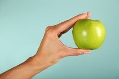 Green apple. In the woman's hands Royalty Free Stock Image