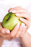 Green apple in woman's hands Stock Photo