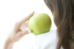 Green apple on the woman's shoulder Royalty Free Stock Photography