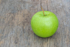 Green  Apple  on  wood background Royalty Free Stock Images