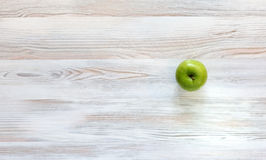 Green apple on wood background Stock Photos