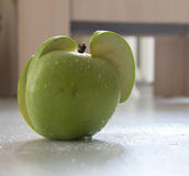 Green apple on wood. Close up green apple with drops on wood background Royalty Free Stock Photos