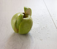 Green apple on wood. Close up green apple with drops on wood background Stock Images