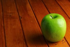 Green apple on wood rustic table Royalty Free Stock Images