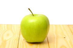Green apple on wood table. Green apple on wood background Stock Photos
