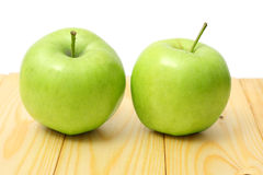 Green apple on wood table. Green apple on wood background Stock Photography