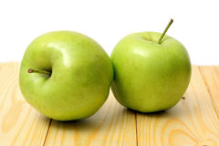 Green apple on wood table. Green apple on wood background Stock Photo