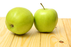Green apple on wood table. Green apple on wood background Royalty Free Stock Photography