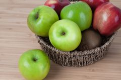 Green apple on wood table.  Stock Photo