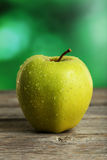 Green apple on wooden background Stock Image