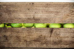 Green apple in a wooden box Royalty Free Stock Photos