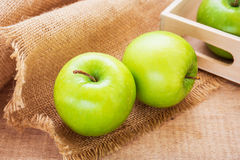 Green apple and wooden tray, filtered image Royalty Free Stock Photos