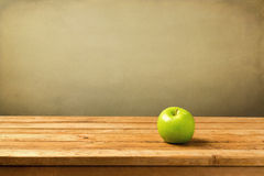 Green apple on wooden vintage table Royalty Free Stock Image