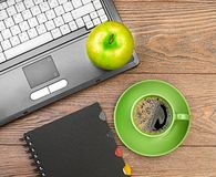 Green apple on worplace Stock Photography