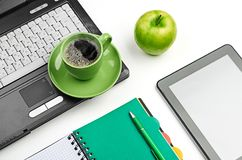 Green apple on worplace Royalty Free Stock Photography