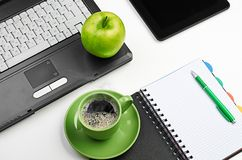 Green apple on worplace Stock Photo